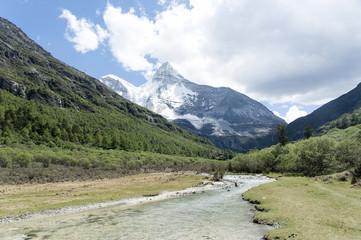Tibet snow mountain with river