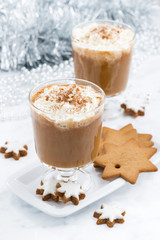 festive pumpkin latte and almond biscuits, top view