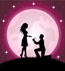 man standing on the knee gives a woman a ring.