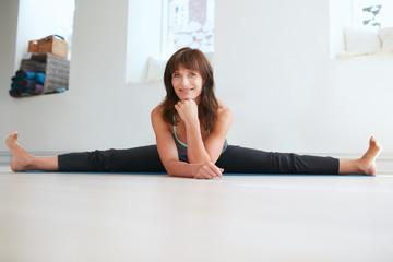 Flexible woman doing the splits - Upavistha Konasana