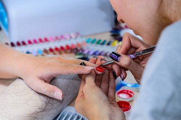 closeup of manicurist at work in the salon nail (shallow DOF; co