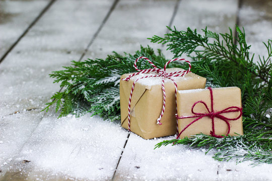 Brown paper packages on winter background
