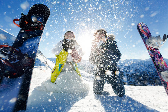 bride and groom in love throw snow background of the Alps Courch