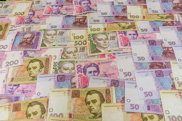 different ukrainian banknotes background close-up
