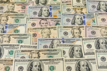 different usa dollars bills as background