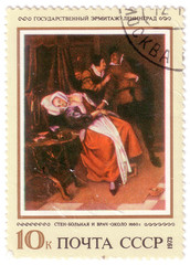 USSR - CIRCA 1973: The postal stamp printed in USSR is shown by the doctor measures pulse at the sick girl, CIRCA 1973.