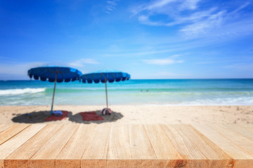 Empty top of wooden table and view of tropical beach