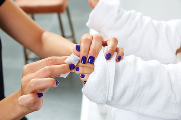 Pedicure treatment to woman feet in nails salon