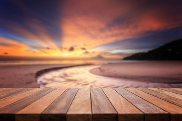 Empty top of wooden table and view of sunset or sunrise backgrou