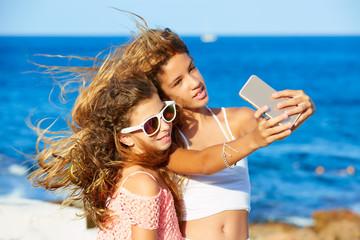 kid teen friend girls photo selfie on the beach