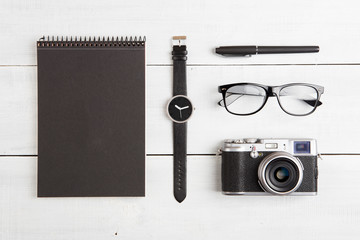 travel concept - set of camera, notepad, watch, glasses and pen