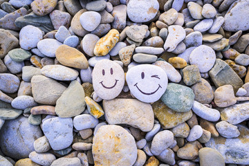 Funny smileys of pebbles