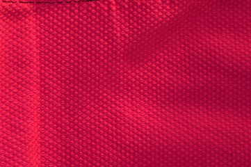 Hot pink textured fabric background