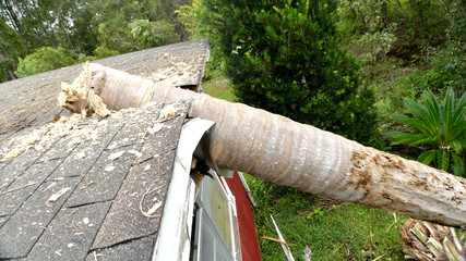 EF0 tornado damage on house roof