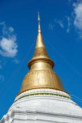 Golden pagoda under blue sky