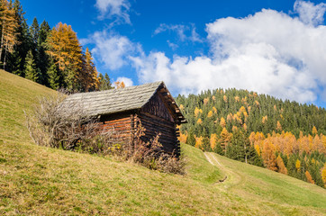 Wooden Hut in the Alps on a Clear Autumn Day