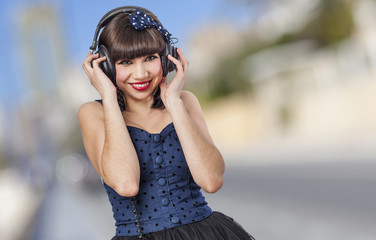 young beautiful pin up girl listening to headphones