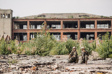 Private Military Contractor on patrol in destroyed city