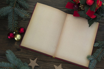 Red Christmas decorations and an open book