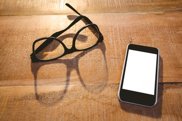 Close up view of smartphone and glasses