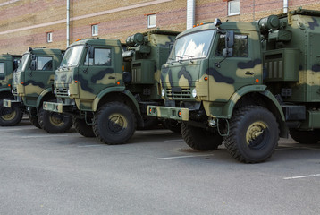 new military trucks on the parking lot