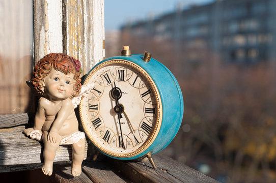 Retro angel girl and vintage clocks