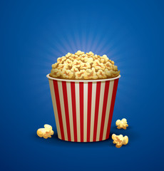 Vector Popcorn Bucket. Image of red and white striped bucket filled with yellow popcorn on a bright blue background.