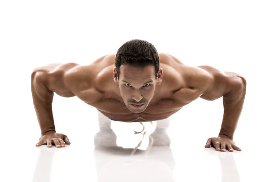 Muscle man making pushups