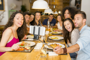 Friends at the restaurant making a selfie