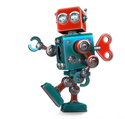 Retro Robot wound up with a key. Isolated. Contains clipping path