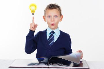 Preschooler boy with finger up, inspiration concept