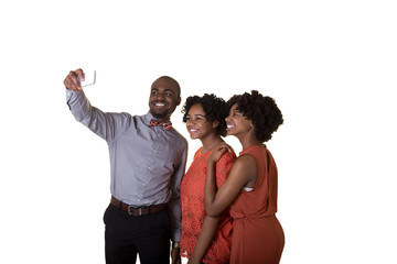 Siblings or group of friends taking a picture with a cell phone isolated on white