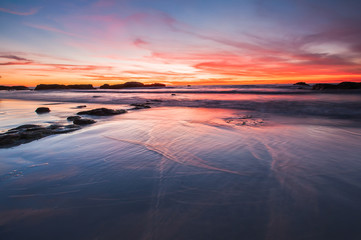 sunset with reflection of wet sand