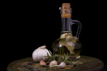 appetizing bottle of olive oil infused with spices, garlic and b