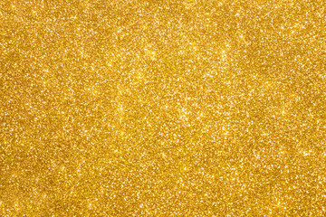 Golden glitter christmas abstract background. Shiny golden lights