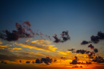 Fotobehang - dark clouds and orange sky
