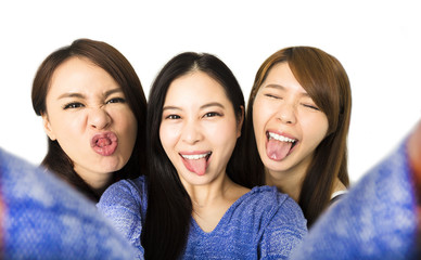 young woman group having fun together and taking selfie