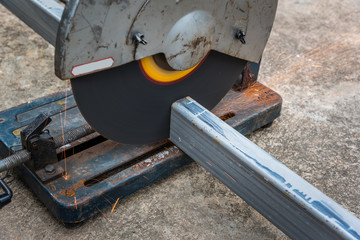 Cutting a square metal and steel with compound mitre saw with cicular blade
