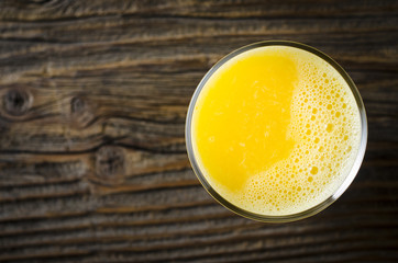 Orange juice over wooden table