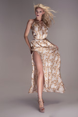 Blonde beautiful woman in maxi dress.