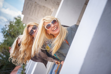 Three blondy women in sunglasses.
