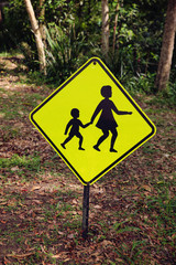 Rustic Yellow children crossing sign, vintage filter