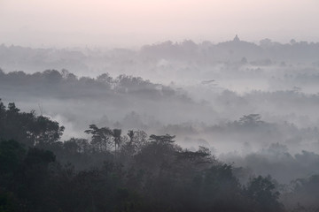 Mist above Borobudur as viewed from Setumbu  hill