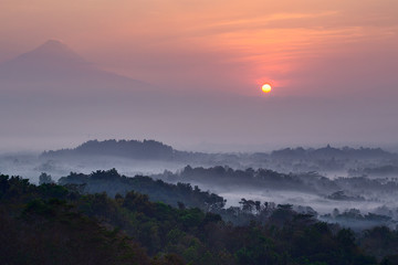 Sunrise at Setumbu hill with the view of Borobudur and  Merapi