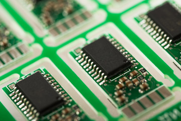 Closeup of green electronic circuit board with processor