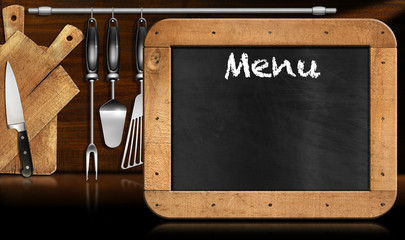 Blackboard Menu in the Kitchen / Old empty blackboard with wooden rectangular frame and text Menu in the kitchen with utensils. Template for recipes or food menu