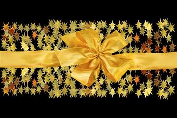 étoiles, ruban et noeud doré sur fond noir