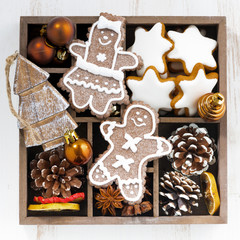 Christmas symbols in a wooden box, top view