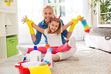 Smiling adorable family ready for cleaning house