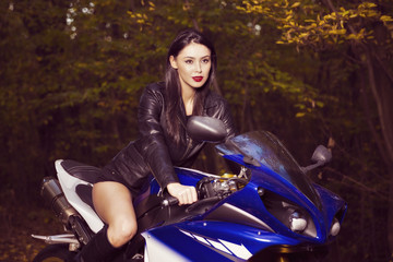 Beautiful Biker girl on a motorcycle